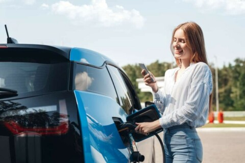 Electric vehicle fast charger plugs in at Forest Glen